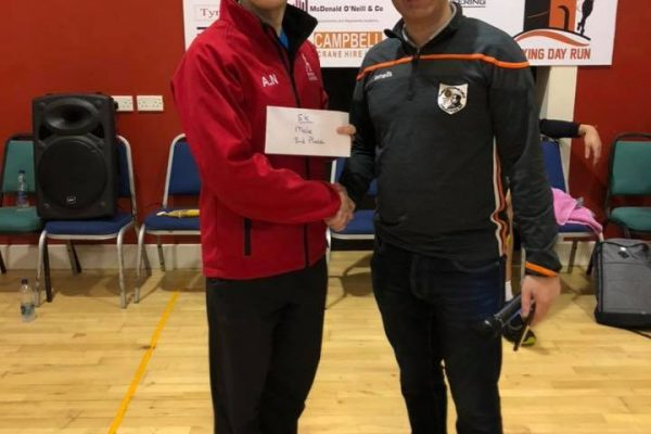 Andrew Newell (left) receiving his prize for 3rd overall in the 5k Brocagh Bay Boxing Day 5k and 10k