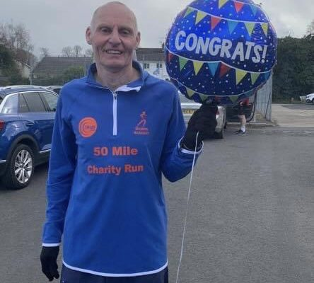 Mark Reid celebrates completing his 50 mile charity run